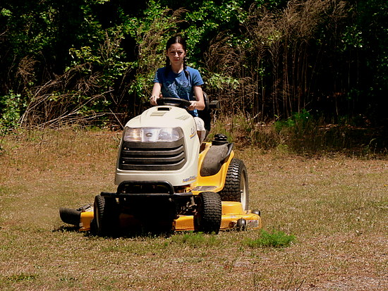 Katelyn mowing the back 40